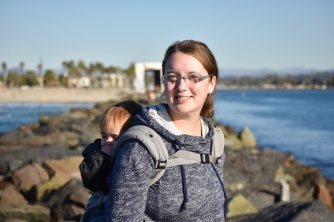 Me and my papoose climbing on the jetty at South Mission Beach